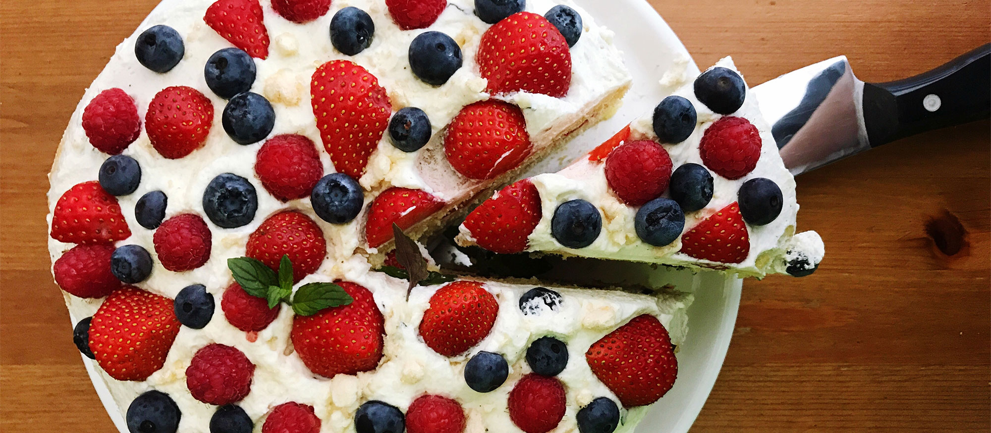 Cake with berries served on a table.